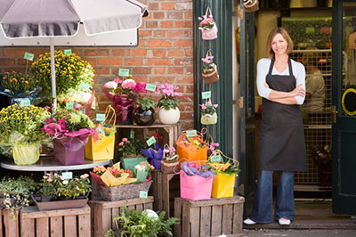 image of business owner outside of her kentucky flower shop