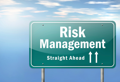 road sign with the words risk management straight ahead